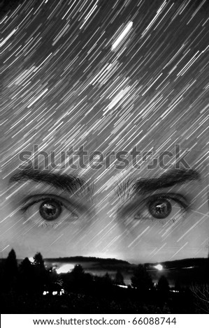 Star trails long exposure at night. Concept photo demonstrating believers of UFOs, alien lifeforms, and extraterrestrial beings.Copyspace above the eyes. - stock photo