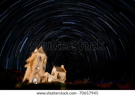 star trails over castle in south africa, free state, pointing south - stock photo