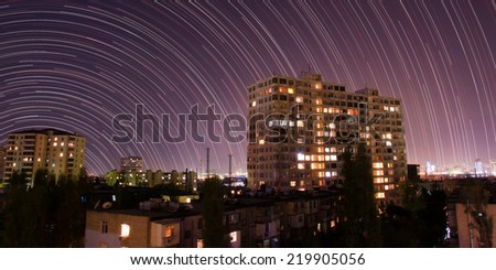 Star trails over the night city