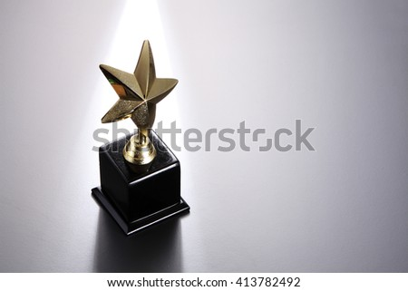 star trophy on the gray background - stock photo