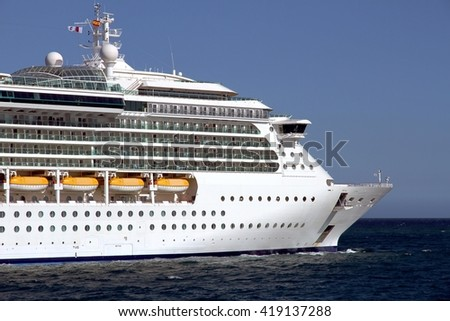 Starboard Side Luxury Cruise Leaving Port Stock Photo - Port or starboard side of cruise ship