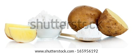 Starch in spoon with potatoes isolated on white - stock photo