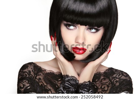 Stare. Fashion model girl face, beauty woman makeup and Bob black hairstyle. Brunette woman posing isolated on white background. - stock photo