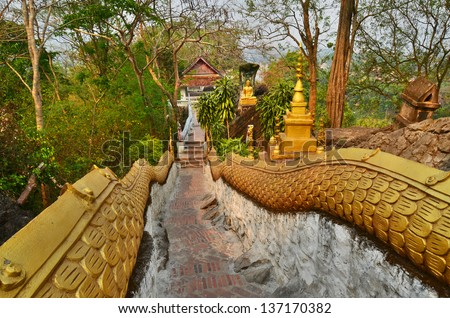 Stares of Mount Phousi, also written Mount Phu Si is a hill right at the centre of the old town of Luang Prabang. It is bordered on one side by the Mekong River and on the other side by the Khan River - stock photo