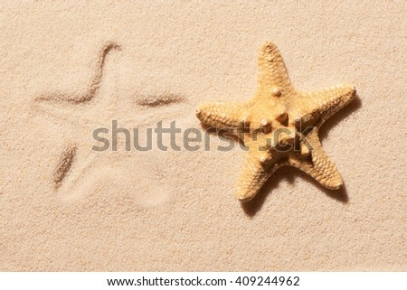 Starfish and mark of starfish on sand. Summer beach background. View from above - stock photo