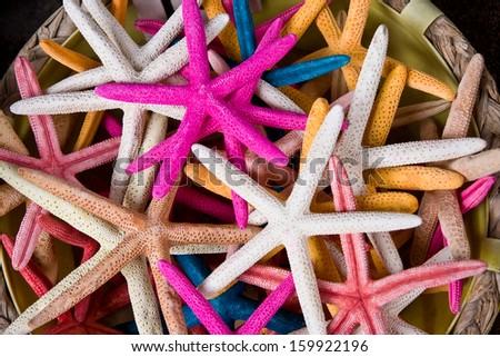 Starfish of various color as a background. Souvenir shop, Costa Brava, Spain