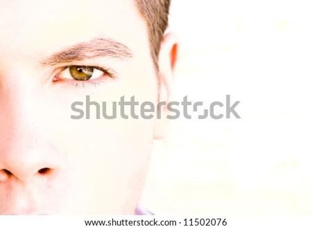 Staring man close portrait in high key. - stock photo