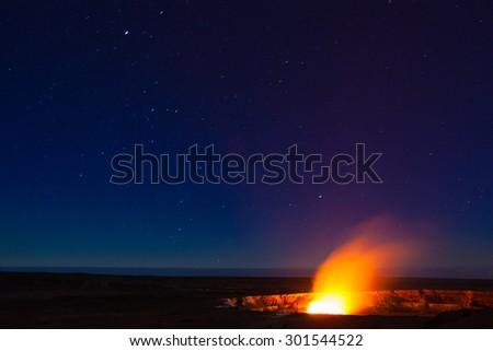 Starry night photos of erupting volcano in Hawaii Volcanoes National Park, Big Island, Hawaii. Night photos, multiple minute exposure. - stock photo