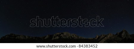 Starry night sky above rocky cliffs. Natural stars panorama photo - stock photo