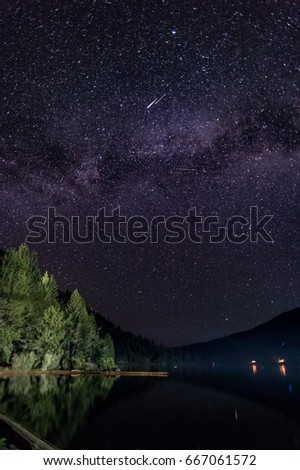 Starry Sky Over Lake With A Shooting Star
