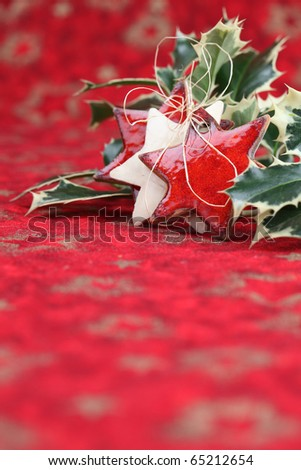 Stars and holly twig on Christmas background. Shallow dof - stock photo