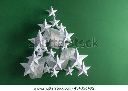 Stars and ribbon form a Christmas tree