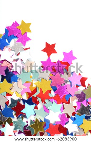 Stars in the form of confetti on white - stock photo