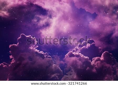 Stars in the night sky,puple background. - stock photo