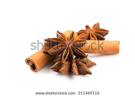 Stars of anise and cinnamon on white background