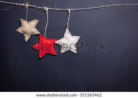 Stars on empty chalkboard background