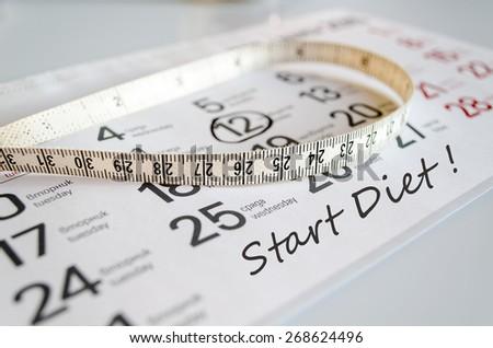 Start Diet Concept - Tape Measure On Calendar  - stock photo