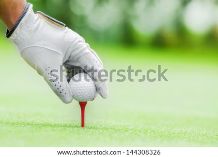 Start game by put the golf ball - stock photo