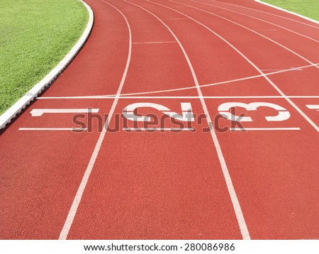 Start line at running track - stock photo
