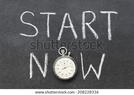 start now concept handwritten on chalkboard with vintage precise stopwatch used instead of O