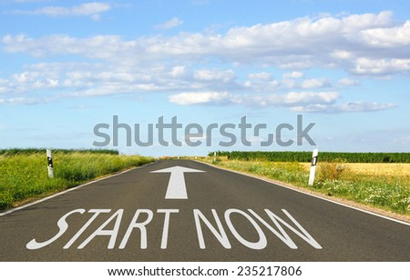 Start Now - Street with arrow and text - stock photo
