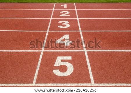 Start or finish position on running track  - stock photo