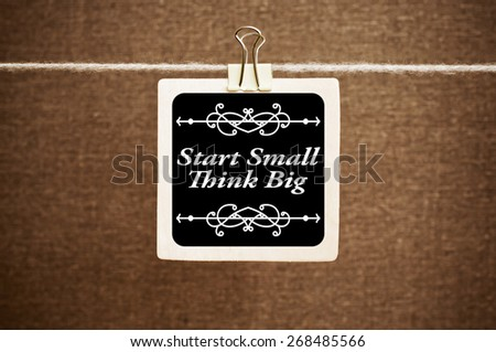 Start Small Think Big. Message text with Vintage Monogram - stock photo