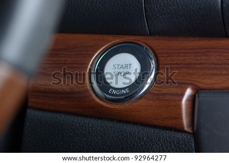 Start stop engine button on the car panel - stock photo
