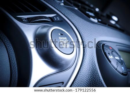 START/STOP ignition button in car, vehicle with visible fragment of instrument panel in vehicle interior. - stock photo