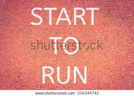 Start to run concept with word on running track,Red running tracks  run lane background texture,vintage color - stock photo