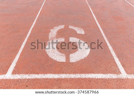 Start track. Lanes 6, number six of a red racing track. - stock photo