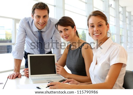 Start-up company presenting results on computer screen - stock photo
