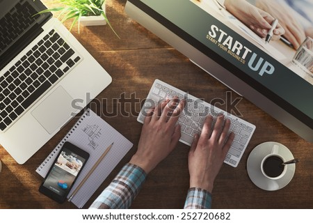 Start up corporate identity website on laptop, digital tablet and smart phone, business desktop - stock photo