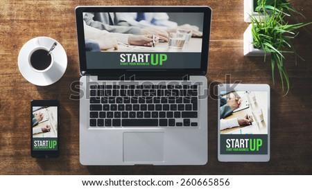 Start up corporate identity website on laptop, digital tablet and smart phone, business desktop - stock photo