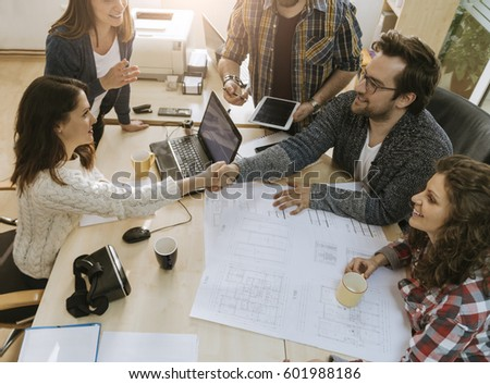 Start Up Team Of Freelancers In The Office Making A Deal