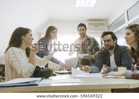 Start Up Team Of Freelancers In The Office Planning