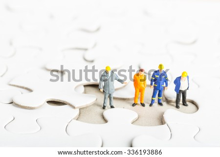 Start up your business idea of Engineer team with jigsaw puzzle. - stock photo