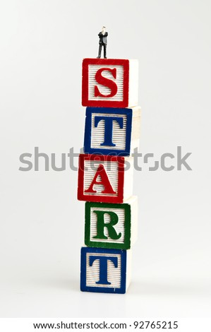 Start word and toy business man - stock photo