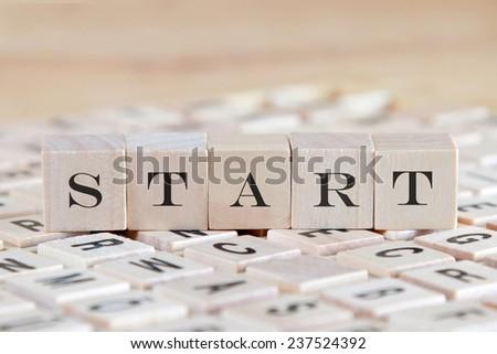 start word on wood blocks - stock photo