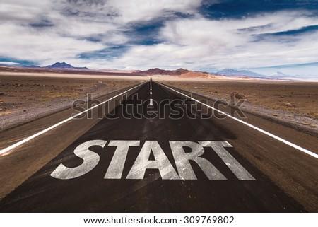 Start written on desert road - stock photo