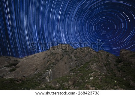 Startails in mountain area in night,china - stock photo