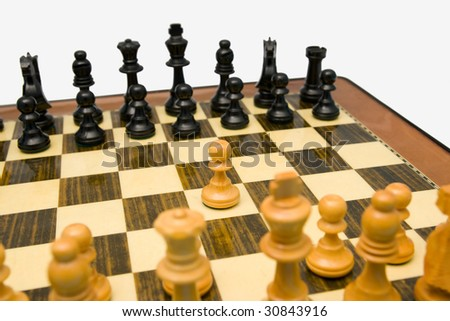 Starting a chess match with king pawn opening - stock photo