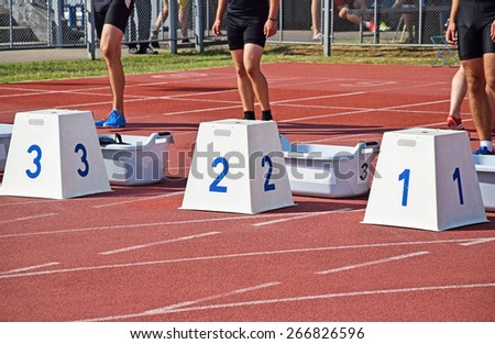 Starting block of the running track - stock photo