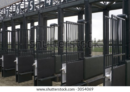 Starting gate for a horse race - stock photo
