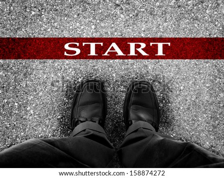Starting line for race with businessman in dress shoes         - stock photo