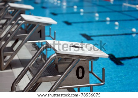 Starting platforms with numbers for swimming races - stock photo