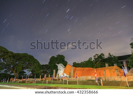 Startrail over big buddha image at Thailand - stock photo