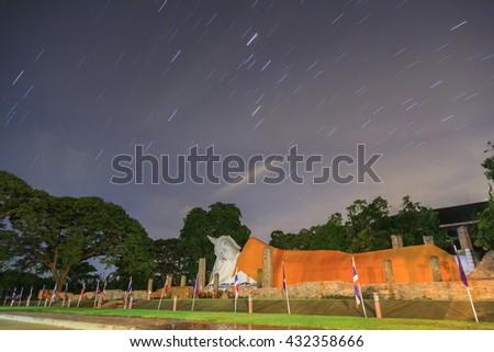 Startrail over big buddha image at Thailand - stock photo