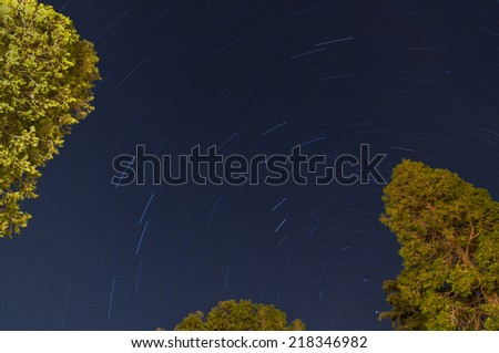 Startrails in the forest of Lake Arrowhead, California - stock photo