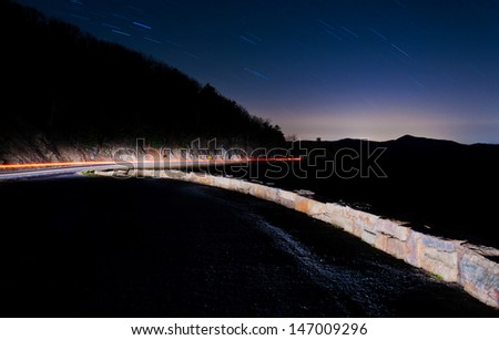 Startrails over the Blue Ridge and Skyline Drive in a long exposure taken at night, Shenandoah National Park, Virginia. - stock photo